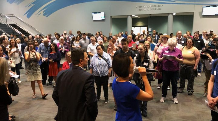 KHQ reporters greeting crowd