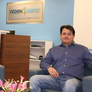 Man sitting in Work Source lobby